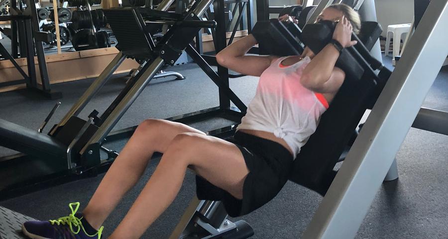 Carola Landerer on the leg press in her gym