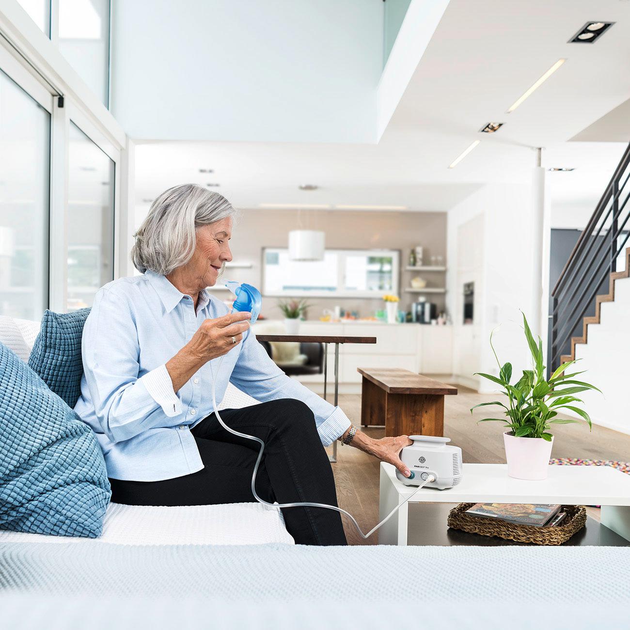 Older-woman-inhales-with-the-PARI-BOY-Pro.jpg